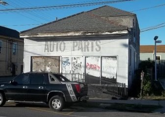 This former auto parts building on St. Claude Avenue was sold to the neighboring gas station rather than being auctioned in public. Three years later, the property hasn't been developed.