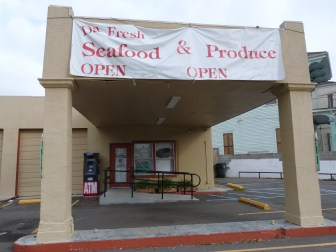 The big sign out front says DaFresh Seafood & Produce is open, but signs on the windows and doors say it's closed. Owner Doug Kariker said he's selling the store because it was too much work. The store received a low-interest loan meant to expand fresh food offerings in under-served neighborhoods.