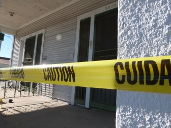 The house at 3016 Leonidas St. was falling apart and covered in caution tape when we surveyed it.