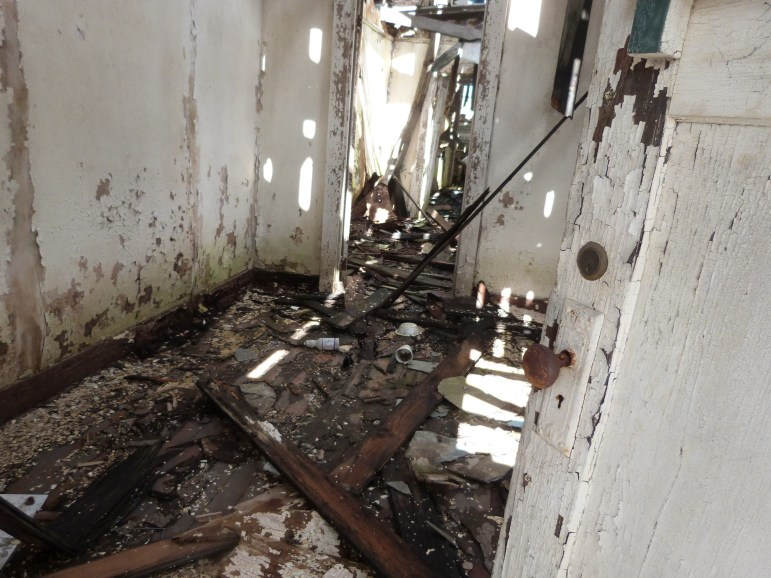 When The Lens visited his house in Hollygrove last week, the front door was open, revealing holes in the roof and second floor and a water-damaged first floor. The house is set to be torn down.