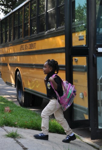 A student walks off the bus at John Dibert Community School, one of the many charter schools in New Orleans under the auspices of the Recovery School District.