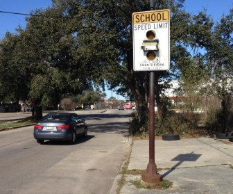 A school zone beacon remains on Washington Avenue in Central City, but there's no school nearby.