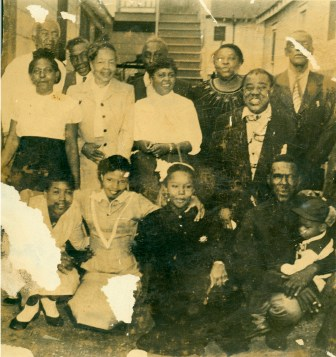 A rare photograph shows Armstrong, right, with members of his father's family, during a 1950 visit to Gert Town.