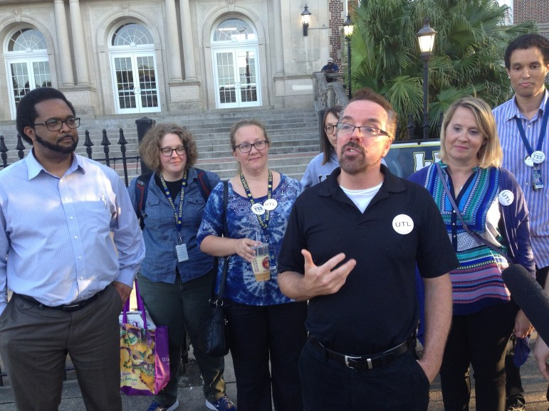 Theater teacher Terry Marek and other members of United Teacher of Lusher speak to reporters on May 17 after ballots were counted in the union election. Teachers voted against the union while teachers' aides voted for it.