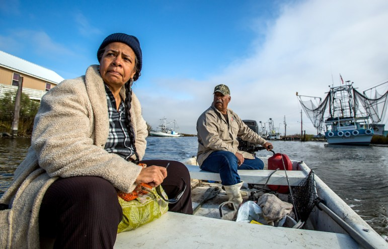 Rosina Phillipe, left, and her brother, Maurice Phillips, boat along Grand Bayou south of New Orleans recently. 'For us, home is more than the building you live in – it's everything in the environment that surrounds you,' said Phillipe, an elder of the Atakapa-Ishak/Chawaska tribe. 'If you leave you become someone else.'