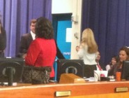 Council members kill time after the scheduled 9 a.m. start of their meeting this morning. Photo by Steve Beatty