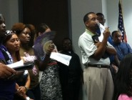 Audience members audit a recent Orleans Parish School Board committee meeting. photo: The Lens/Danielle Bell