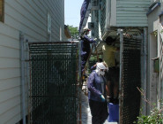 This crew is wet sanding lead-based paint from a house, in keeping with city regulations. Photo by Editor B via Flickr