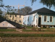 The house on the left collapsed due to Hurricane Isaac; the house on the right has also been slated for demolition due to damage from the story. (Karen Gadbois)