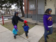Charmaine Williams, second from left, goes for a walk with her grandchildren Keah Williams, 15 months, left, and Richard 'Ricky' Farrell III, 3; and daughter, SaYann Williams, 16, right, Tuesday in the Iberville public housing development. The development is across the street from St. Louis Cemetery No. 2. Advocate staff photo by Scott Threlkeld.
