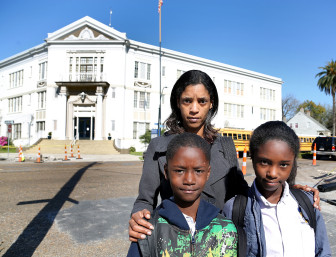 Anika Watson and her son Kaleb and daughter Kaliyah outside McDonogh City Park Academy where the children attend school on Thursday, March 14, 2013. Watson learned days after the start of the school year that her kids' new school was an F. The district offered her children a list of schools to which they could transfer, but even those options were lackluster.
