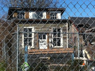 Vagrants dwell in a shack they have built on the property, neighbors say.