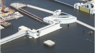 The barge gate is show in the closed position with the sector gate left open.