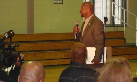 Former L.B. Landry football coach Derek LaMothe addresses the crowd at a public hearing on the Landry-Walker merger on Wednesday night.