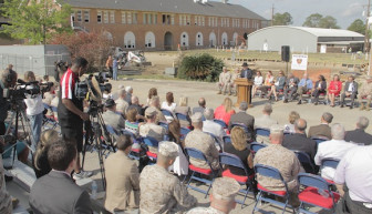 Cameras whirr as board chairman Col. Terry Ebbert addresses the crowd.