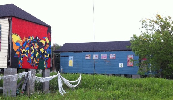 Volunteer artists have  adorned relocated houses with murals and missing architectural details.