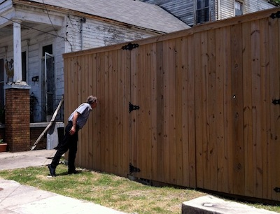 This fence in the Bywater neighborhood is also on Friday's agenda.
