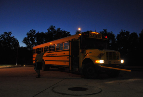 Jenny Joseph waves goodbye to her sons after they board their bus at 6 a.m. in eastern New Orleans last week.