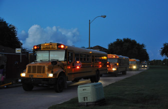 Three buses that pick up students for three different charter schools arrive at Michoud Boulevard and Adventure Avenue around 6:15 one morning.