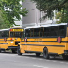 Buses line up at John Dibert Community School near City Park.