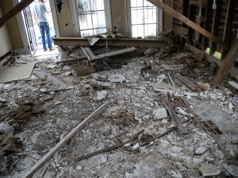 The ceilings had collapsed onto the floor.