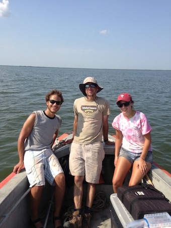 "Tulane's Alex Kolker, center, with research associates Dan Coleman and Annie Schneider, search for the ""missing river."" Kolker became interested in the subject while swimming in a part of Barataria Bay that he expected would be more saline."