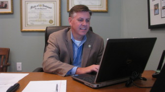 State Rep. Chris Broadwater, R-Hammond, checks government websites for compliance with his law requiring that a custodian of records be listed.