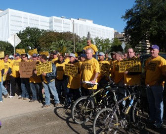 Firefighters protested outside City Hall before the start of Fridays budget hearings, which looked at the Fire Department's budget and under-funded pension.