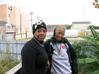 Marietta Ruffins, left, and neighbor Ruby Johnson can see the site of the proposed plant from Ruffins' back porch.