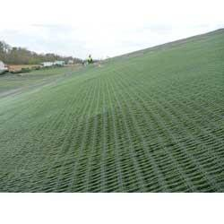 Synthetic mats like this one can avert scouring and erosion on the landward side of a grassy levee that's been overtopped.