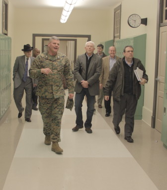 New Orleans Military and Maritime Academy Commandant Col. Bill Davis leads school board members on a tour of its new building.