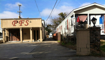 Two of seven properties that would be razed to make room for a CVS pharmacy.