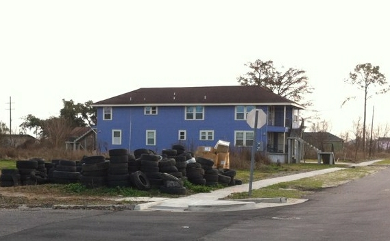 Jon Johnson's property on Deslonde Street in the Lower 9th Ward has been repaired, though a pile of tires mars the property next door.