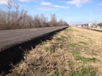 The U.S. Army Corps of Engineers has delayed the opening of the bike path along the Mississippi River until the contractor can address a sharp drop on the side of the path.