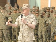 Gen. Richard Mills, U.S. Marines commander, speaks at the recent dedication of the school's new campus.