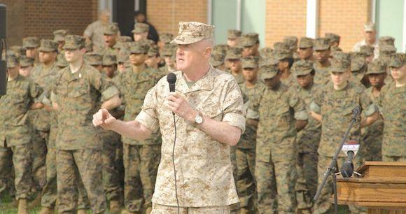 Gen. Richard Mills, U.S. Marines commander, speaks at the recent dedication of the school's new campus.