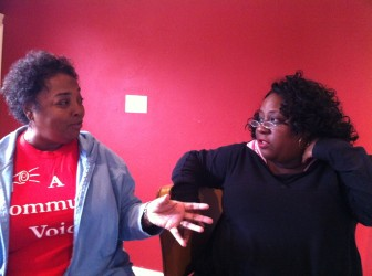 Vanessa Gueringer, left, and Kim Ford discuss the Holy Cross project and the public-relations campaign supporting it.