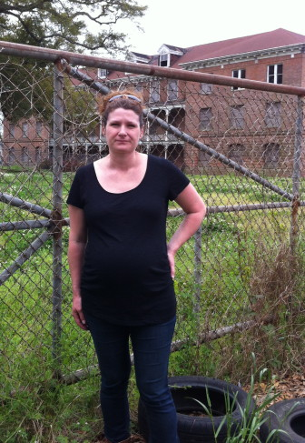 Sarah DeBacher stands in front of the vacant Holy Cross school administration building. She's one of the leaders of a fight against Perez Architects' proposal to build a residential and commercial complex on the site.