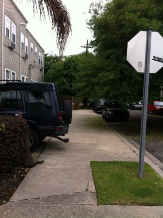 Unpermitted parking spaces at 4007 Prytania St. protrude out over the sidewalk. The building owner seeks a waiver to make them legal, years after they were created.