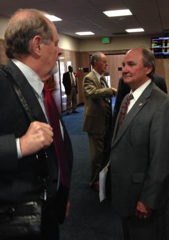 Adley has a quick moment with fellow Republican Jack Donahue of Mandeville in a Capitol corridor.