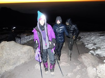 Nearing collapse, Glassman and her group make the final assault on Kilimanjaro's summit, with lamps on their heads to light the way.