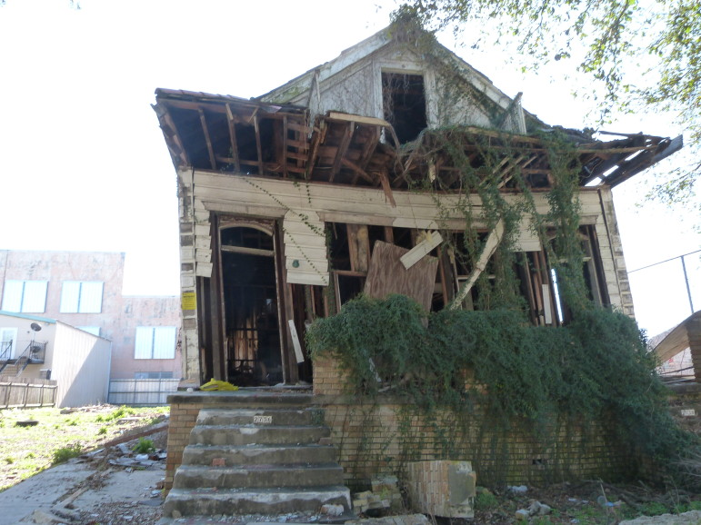 """2736 Banks St. in Mid-City appeared on the city's """"completed demolition"""" database in January, but it was still standing when we checked. The house was leaning precariously and it was exposed on the front and side. The city later removed the property from its list."""