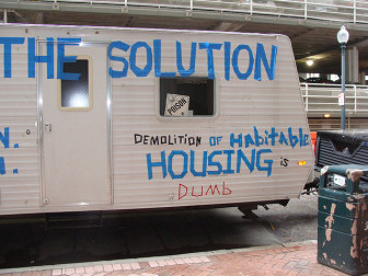 Part of the Hurricane Katrina recovery focused on demolition of damaged houses. The owner of this travel trailer suggested that demolition was not a the solution.