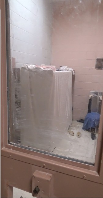 "This image from a video shot inside Templeman V shows an inmate who has covered his window with soap and created a ""cocoon"" around his bunk to hide from guards."