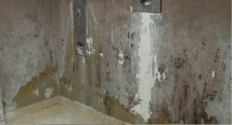 "This image from OPP a video inside Templeman V, taken by consent decree monitor Susan McCampbell, shows the showers at Templeman V, which she called ""appalling."""