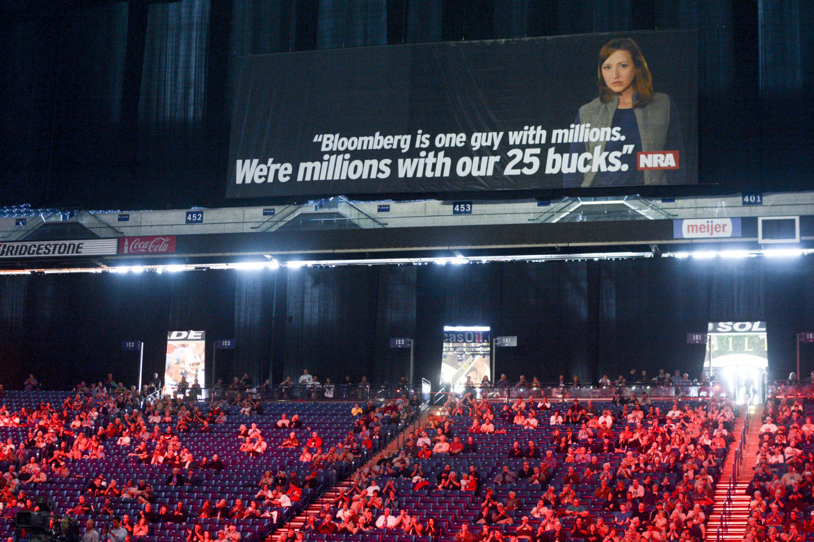 "An NRA convention video labels Michael Bloomberg the group's ""enemy"" given the former New York mayor's million-dollar donations to gun control proponents. Posters echoing the message filled the Indianapolis venue."