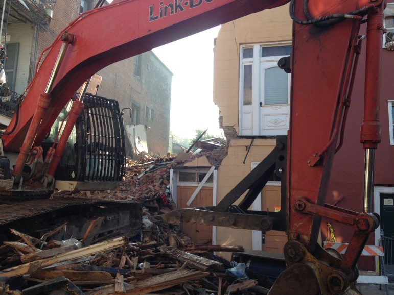 A bulldozer scrapes the lot at 810 Royal St. following collapse of a 200-year-old French Quarter building.