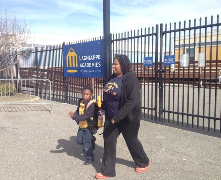 Alicia Parker leaves Lagniappe Academies with her son Anthony Jr. on Friday afternoon. The state voted that day to close the charter school, effective at the end of the year. Parker wishes new leadership would be put in place instead instead of shuttering the school.