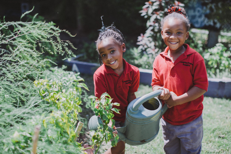 Langston Hughes students Trinity Young and Kayla Watson get an up-close look at locally sourced food through the Edible Schoolyard program.