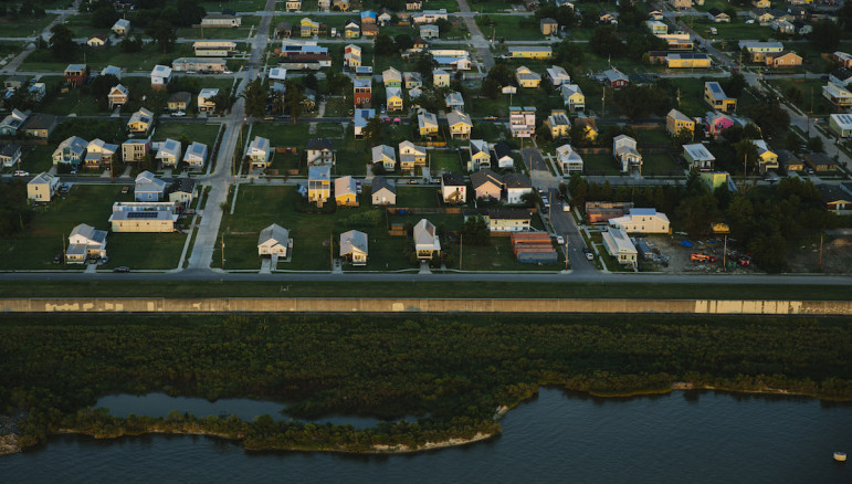 A new, stronger levee and flood wall protects the Lower 9th Ward from the Industrial Canal. This was the section that failed after Hurricane Katrina, letting a barge float through and flooding the working-class neighborhood and washing away home.